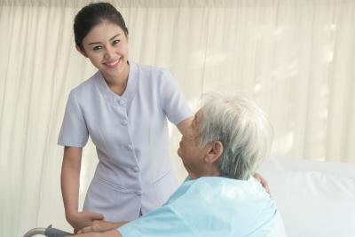 nurse smiling with senior woman