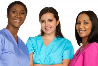three female caregivers smiling