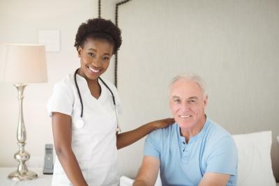 nurse smiling with senior man
