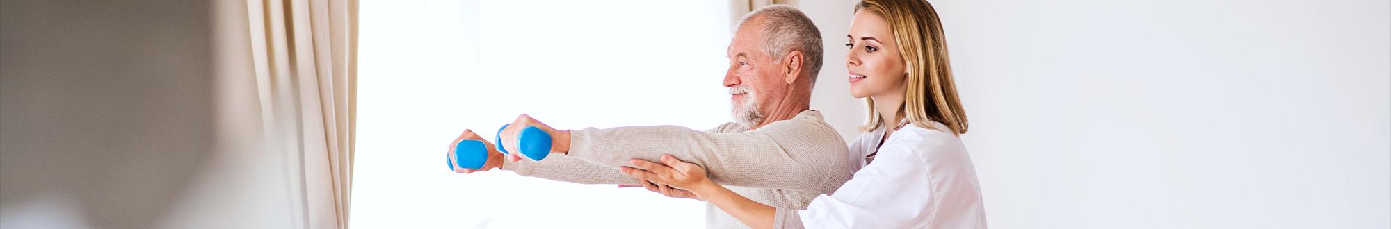 caregiver helping senior man stretch